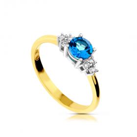 Złoty pierścionek blue topaz i brylanty.
